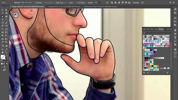Dessin homme en train de dessiner sur sa tablette